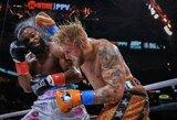 Vangų buvusį UFC čempioną T.Woodley įveikęs J.Paulas –vis dar nenugalėtas