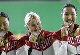 Kodėl olimpiniai prizininkai kandžioja iškovotus medalius? Atsakymą pateikia istorikas bei lengvaatletė