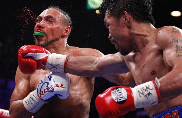 Manny Pacquiao ir Keitho Thurmano kovos akimirka