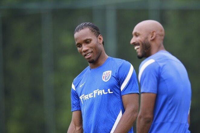 Didieras Drogba (kairėje) ir Nicolasas Anelka (kairėje) | AFP/Scanpix nuotr.
