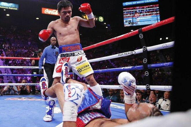 Manny Pacquiao ir Keitho Thurmano kovos akimirka | Scanpix nuotr.