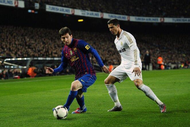 Lionelis Messi (kairėje) ir Cristiano Ronaldo (dešinėje) | AP/Scanpix nuotr.